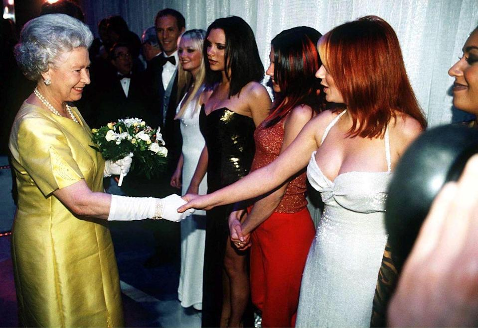 <p>The Spice Girls showed up to their Royal Command Performance dressed to the nines. But to be honest, the Queen still stole the show in that bright yellow number. Not that it's a competition. Girl power!</p>