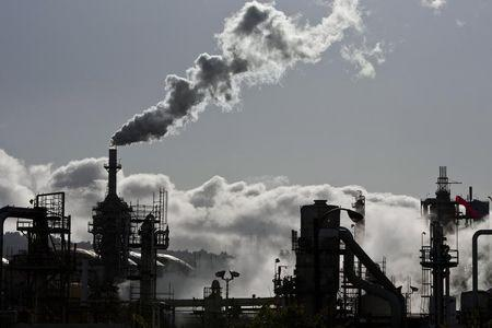 Smoke is released into the sky at the ConocoPhillips oil refinery