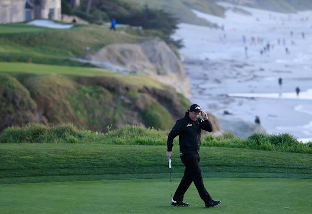 Phil Mickelson reacts to his birdie on the ninth green in the weather-disrupted final round of the 2019 Pebble Beach Pro-Am (AFP Photo/CHRIS TROTMAN)