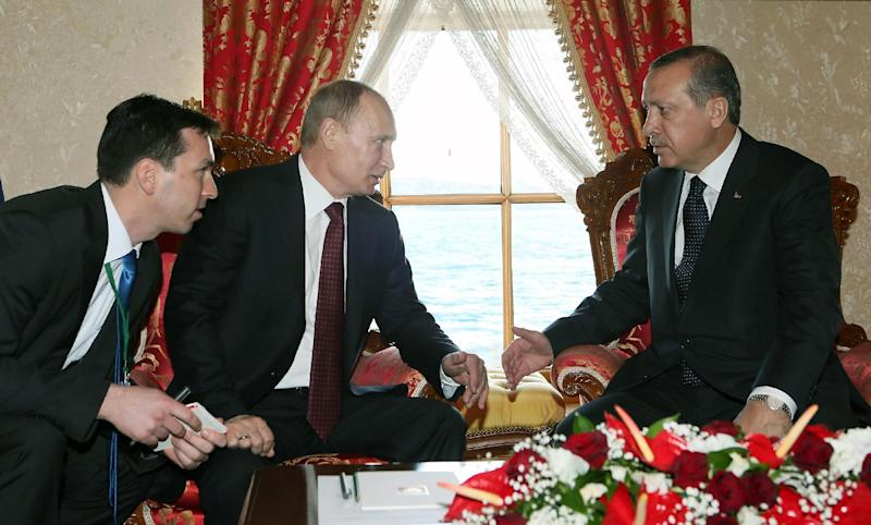 Russian President Vladimir Putin, second left, and Turkey's Prime Minister Recep Tayyip Erdogan speake before a meeting in Istanbul, Turkey, Monday, Dec. 3, 2012. Putin visits Turkey on a one-day trip expected to focus on economic issues as well as differing views over how to resolve the Syrian conflict. Unidentified translator at left.(AP Photo/Pool)