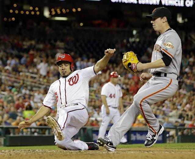 Washington Nationals' Anthony Rendon (6) scores on a wild pitch as San Francisco Giants starting pitcher Tim Lincecum (55) comes in to cover home, during the fourth inning of a baseball game against the San Francisco Giants at Nationals Park Wednesday, Aug. 14, 2013, in Washington. (AP Photo/Alex Brandon)