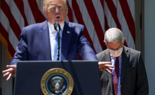 National Institute of Allergy and Infectious Diseases Director Dr. Anthony Fauci looks down as President Donald Trump speaks about administration efforts to develop a COVID-19 vaccine, in the Rose Garden of the White House, in Washington, May 15, 2020. (Kevin Lamarque/Reuters)