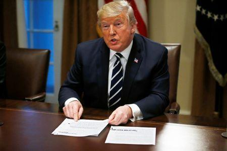 U.S. President Donald Trump speaks about his summit meeting with Russian President Vladimir Putin as he begins a meeting with members of the U.S. Congress at the White House in Washington, July 17, 2018. REUTERS/Leah Millis