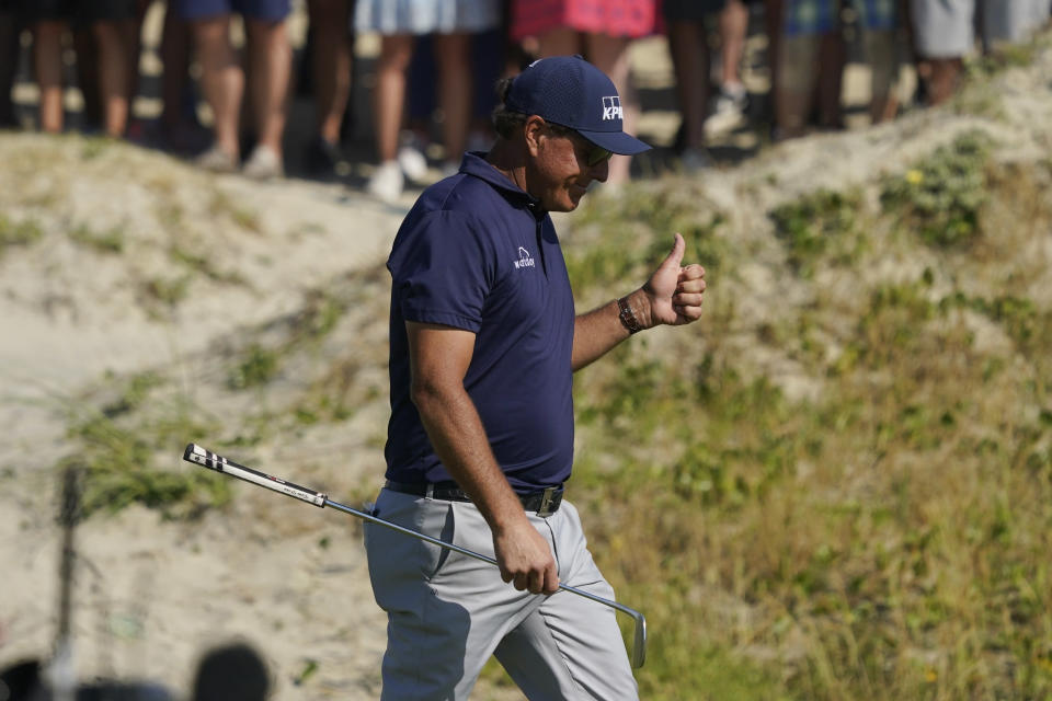 Phil Mickelson walks up the 10th fairway during the final round at the PGA Championship golf tournament on the Ocean Course, Sunday, May 23, 2021, in Kiawah Island, S.C. (AP Photo/Matt York)
