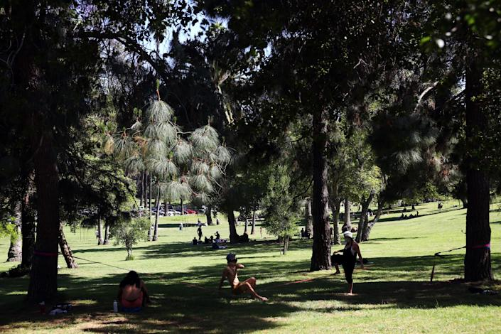 """Visitors enjoy the shade on a hot day in Elysian Park in Los Angeles. <span class=""""copyright"""">(Dania Maxwell / Los Angeles Times)</span>"""