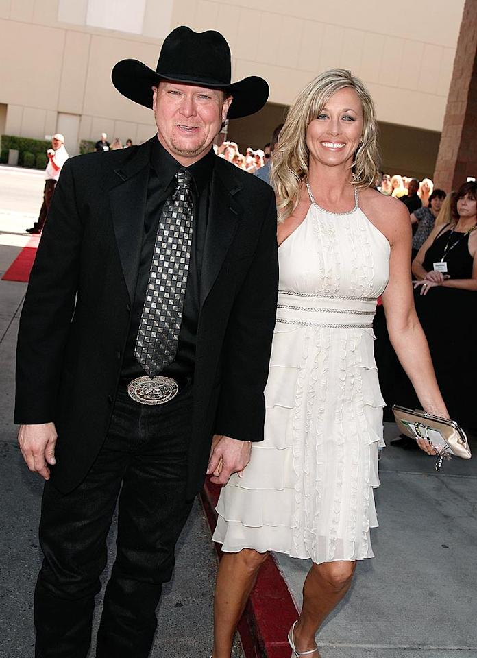 "Although it was over 100 degrees in Vegas, Tracy Lawrence (with wife Becca) opted to wear black from head to toe. We get hot just looking at him! Kevin Winter/ACMA/<a href=""http://www.gettyimages.com/"" target=""new"">GettyImages.com</a> - May 18, 2008"