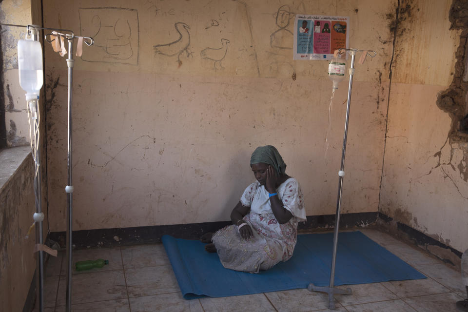 A woman who fled the conflict in Ethiopia's Tigray region waits to get treatment at a clinic in Umm Rakouba refugee camp in Qadarif, eastern Sudan, Wednesday, Nov. 25, 2020. (AP Photo/Nariman El-Mofty)