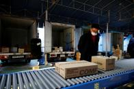 Jeong Sang-rok, a parcel delivery worker for Hanjin Transportation, works at a distribution centre in Gwangju