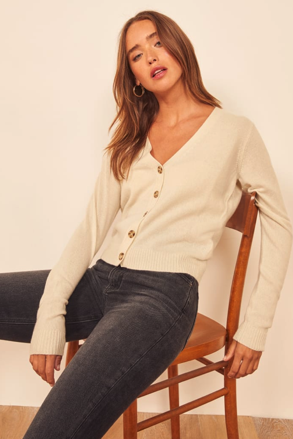 """$148, Reformation. <a href=""""https://www.thereformation.com/products/cashmere-v-neck-cardigan?color=Ivory&glCountry=US&glCurrency=USD&gclid=EAIaIQobChMIoYXyzuet5QIVAobICh0BaQUNEAQYASABEgJrovD_BwE"""">Get it now!</a>"""
