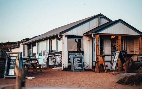 The Beach House is a clapboard shack on South Milton Sands, offering superb seafood on communal tables