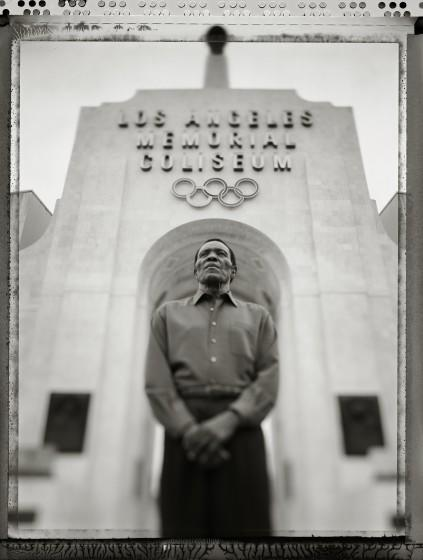 084944.CA.0721.legacy - Rafer Johnson, Olympic decathalon gold medalist and torch bearer at the 1984 Summer Olympic Games photographed in Memorial Coliseum in Exposition Park in Los Angeles under the torch he lit 20 years ago.