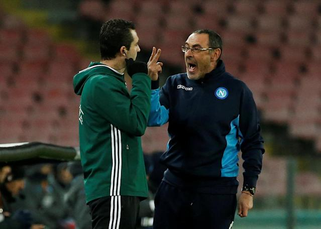 Soccer Football - Europa League Round of 32 First Leg - Napoli vs RB Leipzig - Stadio San Paolo, Naples, Italy - February 15, 2018 Napoli coach Maurizio Sarri speaks with a match official REUTERS/Ciro De Luca
