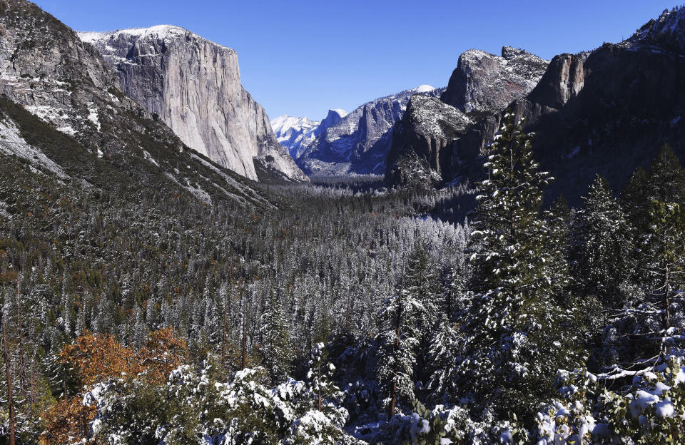 FILE - This Nov. 9, 2020, file photo shows a light dusting of snow covering Yosemite Valley following a weekend snowstorm in Yosemite National Park, Calif. The quest to climb El Capitan and the famous big walls of Yosemite National Park just got a bit harder. Yosemite National Park added some red tape on Friday, May 7, 2021, for climbers to cut through before they can begin the physically grueling, mentally demanding feat that takes several days as they inch up the vertical granite wall and sleep at night suspended on tiny platforms thousands of feet above Yosemite Valley. (Eric Paul Zamora/The Fresno Bee via AP, File)