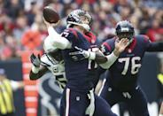 <p>Houston Texans quarterback Brock Osweiler (17) is hit by San Diego Chargers outside linebacker Melvin Ingram (54) on a play during the first quarter at NRG Stadium. Mandatory Credit: Troy Taormina-USA TODAY Sports </p>