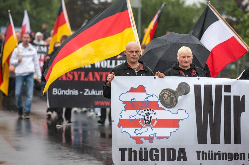 """German right-wing supporters of Thuegida, the local group of the PEGIDA movement """"Patriotic Europeans Against the Islamification of the Occident"""" take part in a march in Suhl, eastern Germany on August 17, 2015 (AFP Photo/Michael Reichel)"""