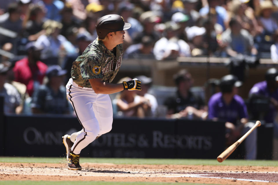San Diego Padres' Ha-Seong Kim watches his RBI-double to left against the Colorado Rockies in the first inning of a baseball game Sunday, Aug. 1, 2021, in San Diego. Padres' Jake Cronenworth and Wil Myers scored on the play. (AP Photo/Derrick Tuskan)