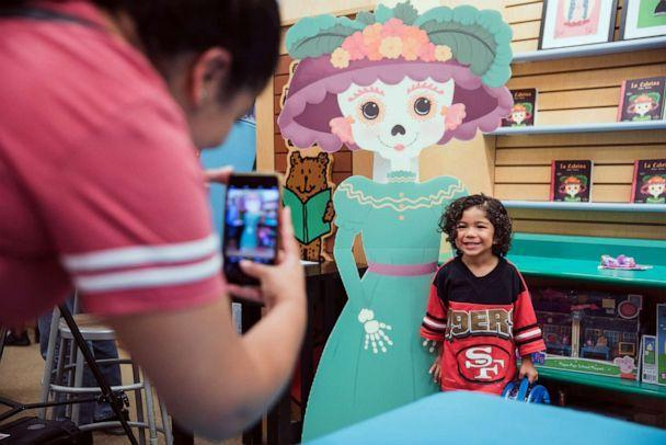 PHOTO: A child poses for a photo at a Lil' Libros book-signing event held at Barnes & Noble in Long Beach, Calif., in September 2017.  (Lily Ro Hernandez)