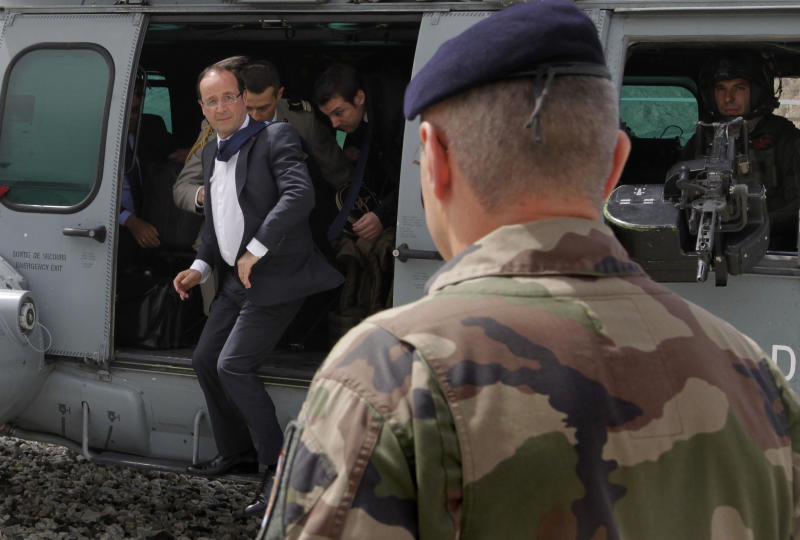 French President Francois Hollande arrives at Forward Operating Base (FOB) in Nijrab, Kapisa region of Afghanistan Friday, May 25, 2012, where most of French troops are stationed in Afghanistan. France's new President Francois Hollande arrived early Friday in Afghanistan to meet with troops and the country's president and discuss plans for an early pullout.(AP Photo/Joel Saget, Pool)