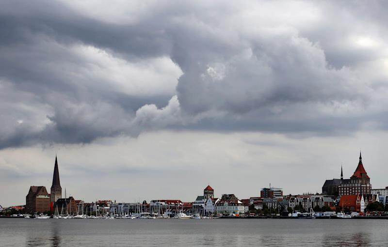 06 August 2019, Mecklenburg-Western Pomerania, Rostock: Over the Hanseatic city at the Warnow dark clouds move away, only now and then sunbeams penetrate through the clouds. Photo: Bernd Wüstneck/dpa-Zentralbild/ZB (Photo by Bernd Wüstneck/picture alliance via Getty Images)