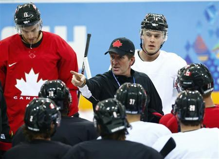 Canada's head coach Babcock directs his team during their men's team ice hockey practice at the 2014 Sochi Winter Olympics