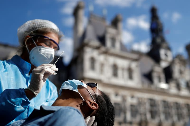 Hospitalisations rise as France's daily COVID-19 cases hit record