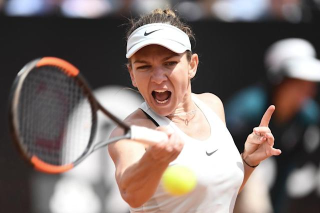 Simona Halep has to reach the Rome quarter-finals to retain the number-one ranking (AFP Photo/Filippo MONTEFORTE)