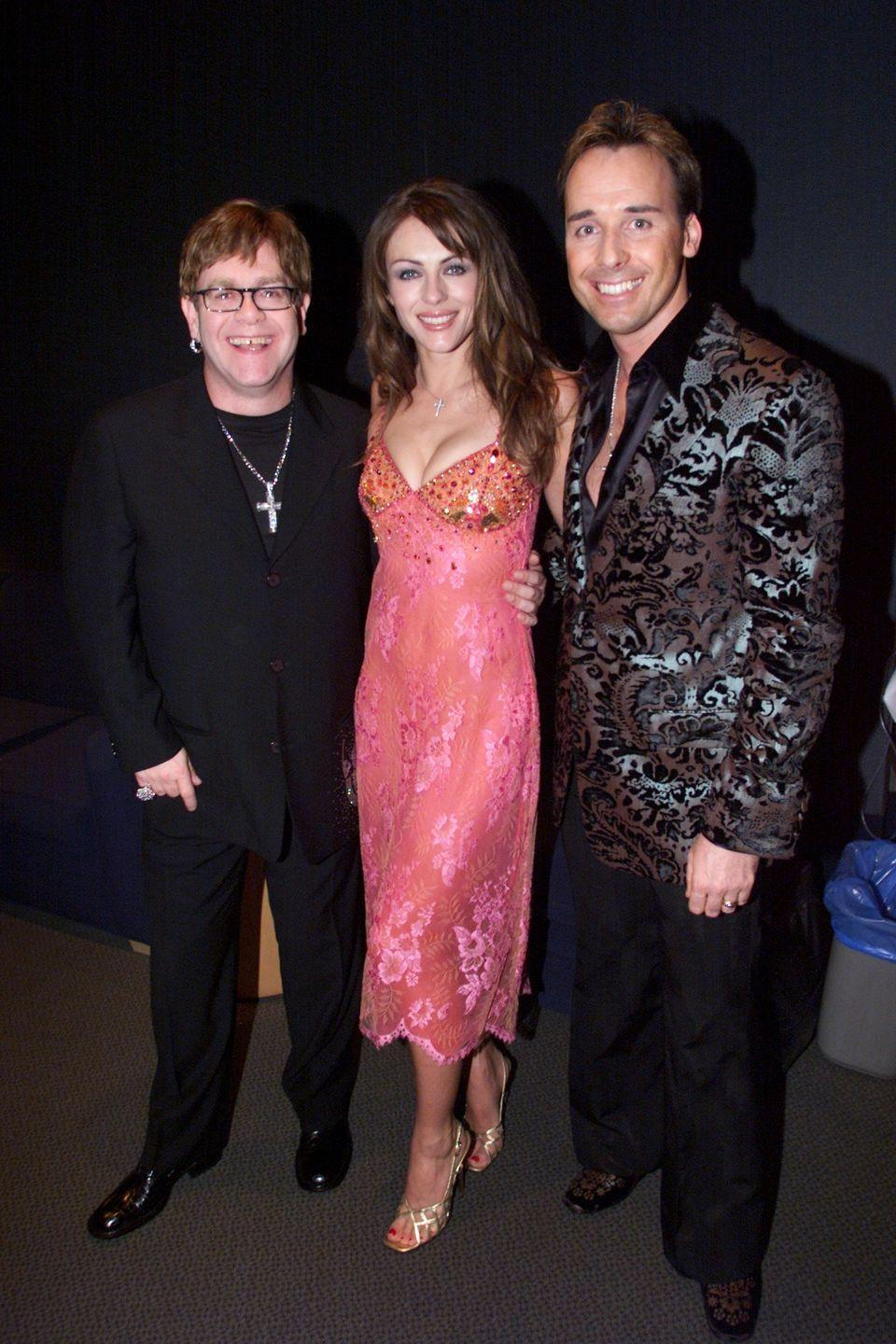 <p>Elton John, a longtime friend of Elizabeth's, was named them2000 MusiCares Person of the Year by the GRAMMY Awards. So, naturally, she showed up to support him. Here she is posing with the singer and his spouse, David Furnish.</p>