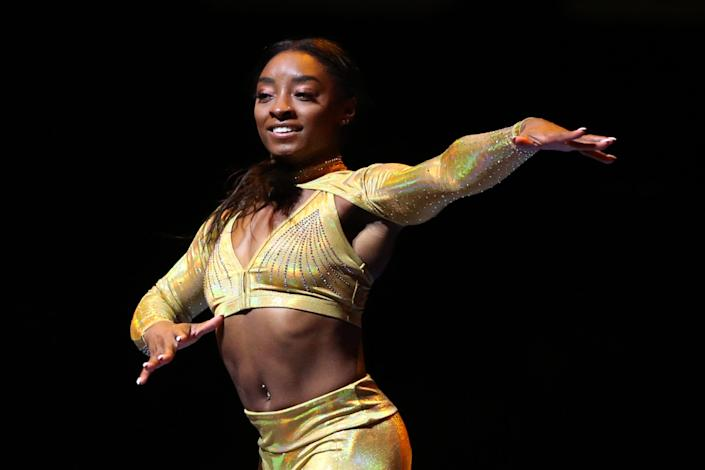 Simone Biles performs during the Gold Over America Tour at Staples Center on 25 September in Los Angeles, California (Getty Images)