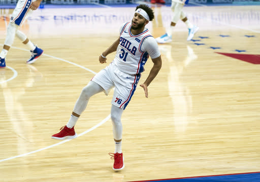 Philadelphia 76ers guard Seth Curry reacts to his three-point shot during the first half of an NBA basketball game against the Washington Wizards, Wednesday, Jan. 6, 2021, in Philadelphia. (AP Photo/Chris Szagola)