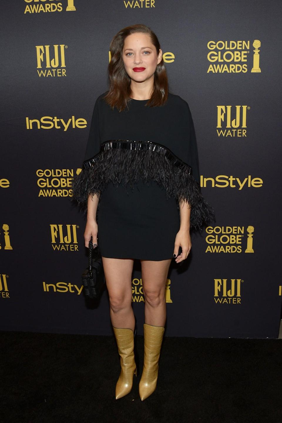 <p>Marion's fringed mini dress and snakeskin cowboy boots inject a sense of fun into this maternity look, proving that pregnancy doesn't equal dull. <i>[Photo: Getty]</i> </p>