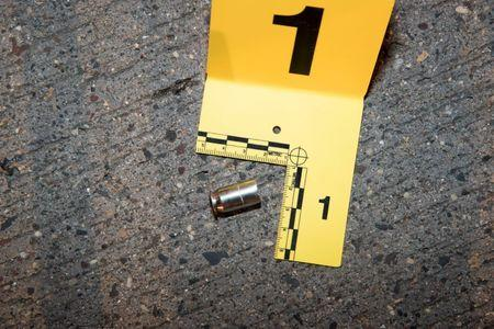A shell casing from a bullet fired at Philando Castile lies outside his car
