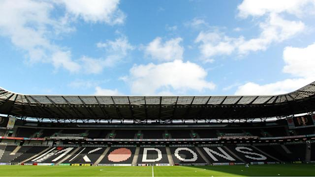 Tottenham have applied to play their home EFL Cup third-round tie in Milton Keynes, but the club's fans are unhappy with the proposal.