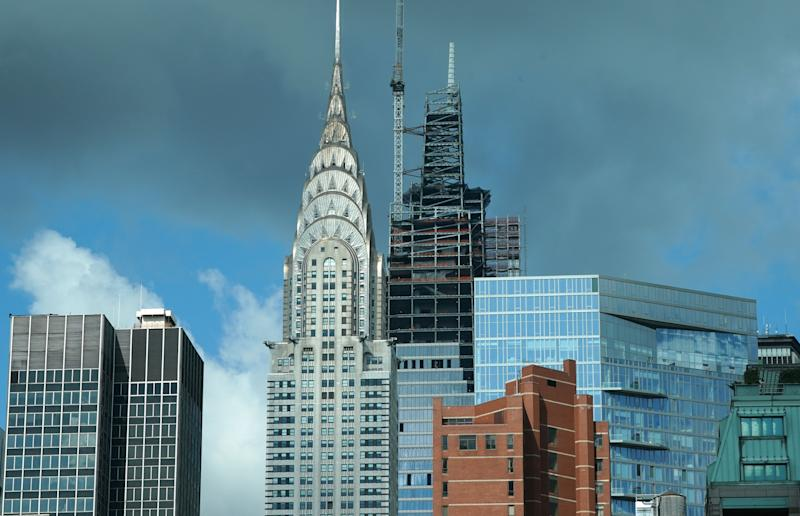 The Chrysler Building stands next to One Vanderbilt on September 18, 2019 as it tops out at 1,401 feet, and becomes the tallest office building in Midtown, New York. - The building is designed by Kohn Pedersen Fox, and the tower is now Midtowns tallest office building and the fourth-tallest skyscraper in New York City. (Photo by TIMOTHY A. CLARY / AFP) (Photo credit should read TIMOTHY A. CLARY/AFP via Getty Images)