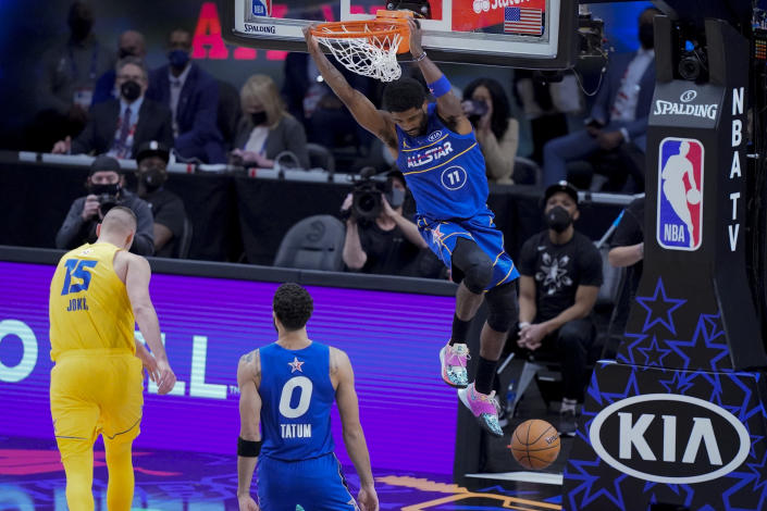 Brooklyn Nets guard Kyrie Irving dunks during the second half of basketball's NBA All-Star Game in Atlanta, Sunday, March 7, 2021. (AP Photo/Brynn Anderson)
