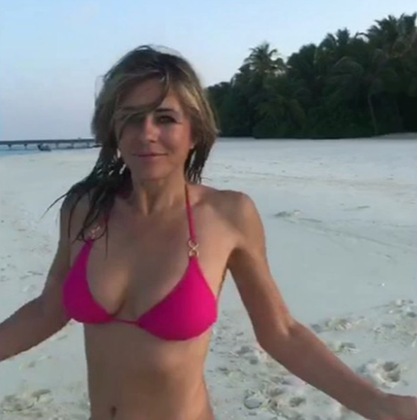 Liz looked sensational dancing on the beach in a pink bikini. Source: Instagram / @elizabethhurley1