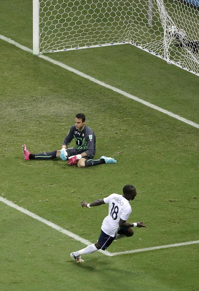 France's Moussa Sissoko, front, celebrates scoring his side's fifth goal past Switzerland's goalkeeper Diego Benaglio during the group E World Cup soccer match between Switzerland and France at the Arena Fonte Nova in Salvador, Brazil, Friday, June 20, 2014. (AP Photo/Sergei Grits)