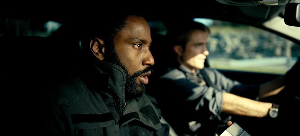 "John David Washington (left) and Robert Pattinson are secret agents dealing with time inversion and an end-of-the-world scenario in Christopher Nolan's sci-fi action movie ""Tenet."""