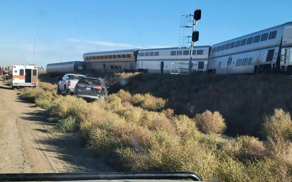An ambulance parked at the scene of the derailment - Kimberly Fossen via AP