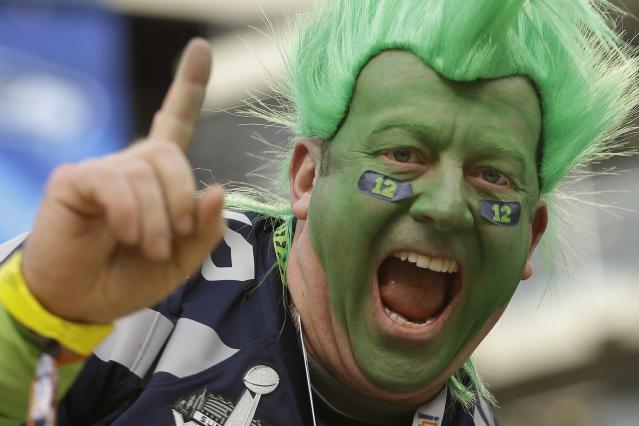 Todd Gibson, from Seattle, cheers for the Seattle Seahawks before the NFL Super Bowl XLVIII football game between the Seattle Seahawks and the Denver Broncos Sunday, Feb. 2, 2014, in East Rutherford, N.J. (AP Photo/Ben Margot)