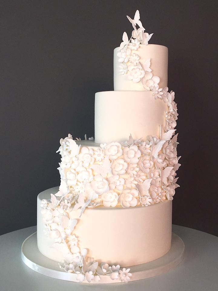 """<p><b>See More:</b> <a rel=""""nofollow"""" href=""""http://www.brides.com/gallery/the-50-most-beautiful-wedding-cakes?mbid=synd_yahoofood"""">The 50 Most Beautiful Wedding Cakes Ever</a></p><p>""""I am so happy that the trend is swinging back to beautiful cakes and away from small plates and dessert bars. It's the first thing guests see at the reception and the last thing they taste. Let it shine!"""" says Kimberly Bailey, chief cake officer of <a rel=""""nofollow"""" href=""""http://thebutterend.com/?mbid=synd_yahoofood"""">the Butter End</a>. She is excited to see her clients heading back toward sleek fondant and lots of sugar work. """"It's not a one-size-fits-all trend the way ruffled cakes were,"""" says Bailey. """"Instead, we're getting really detailed and dimensional, all while keeping the cake monochromatic."""" For a contemporary bride looking for something unique, she created an offset cake with tons of sugar flowers, as well as lots of movement from delicate white butterflies.</p>"""