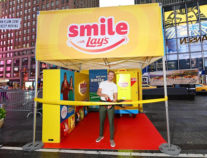 Dancer, actor and singer Derek Hough kicks off the Lay's Smiles campaign by unveiling the first-ever Smiles Station in Times Square, New York City, on July 23, 2019. The station dispenses Lay's limited-edition bags to passerby featuring real people's stories and smiles aimed at helping raise $1 million to Operation Smile.