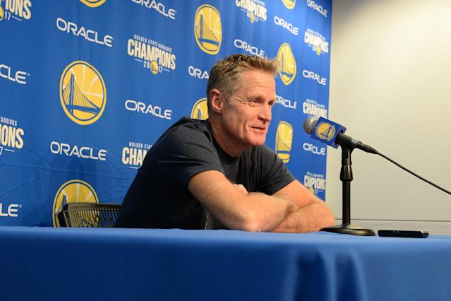"<a class=""link rapid-noclick-resp"" href=""/nba/teams/gsw/"" data-ylk=""slk:Golden State Warriors"">Golden State Warriors</a> head coach Steve Kerr addresses the media before the season opener against the <a class=""link rapid-noclick-resp"" href=""/nba/teams/hou/"" data-ylk=""slk:Houston Rockets"">Houston Rockets</a> on Oct. 17, 2017. (Getty)"