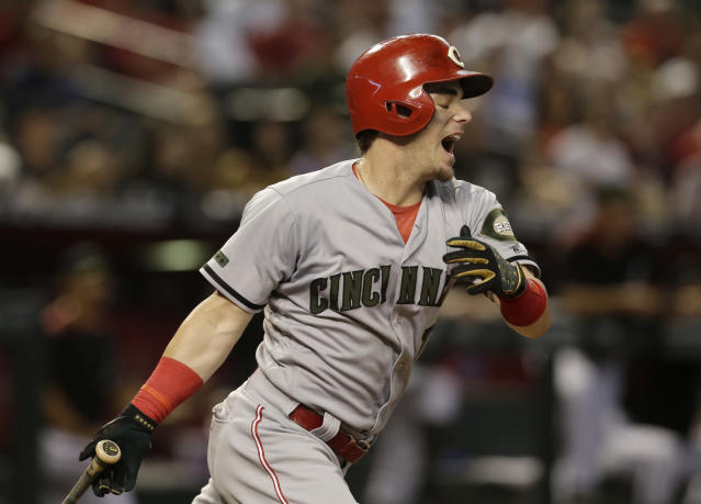 Cincinnati Reds' Scooter Gennett reacts after grounding out in the third inning of a baseball game against the Arizona Diamondbacks, Monday, May 28, 2018, in Phoenix. (AP Photo/Rick Scuteri)