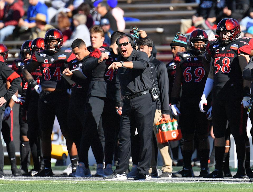 ALBUQUERQUE, NEW MEXICO - DECEMBER 21:  Defensive line coach Brady Hoke (C) of the San Diego State Aztects shouts instructions to hsi team during their game against the Central Michigan Chippewas in the New Mexico Bowl at Dreamstyle Stadium on December 21, 2019 in Albuquerque, New Mexico.  (Photo by Sam Wasson/Getty Images)
