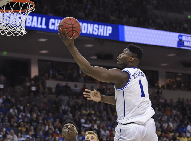 Duke's s Zion Williamson (1) drives to the basket against North Dakota State in a first-round game in the NCAA men's college basketball tournament in Columbia, S.C., Friday, March 22, 2019. (AP Photo/Richard Shiro)