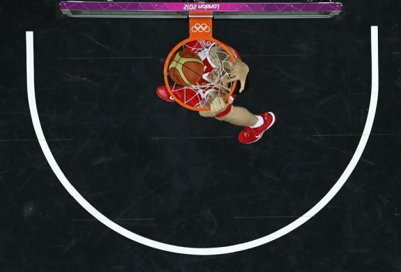 Russia's Sergey Karasev dunks against Brazil during the men's preliminary round Group B basketball match at the Basketball Arena during the London 2012 Olympic Games August 2, 2012.