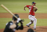 Washington Nationals starting pitcher Gio Gonzalez winds up during the first inning of the team's baseball game against the Miami Marlins, Saturday, July 28, 2018, in Miami. (AP Photo/Brynn Anderson)