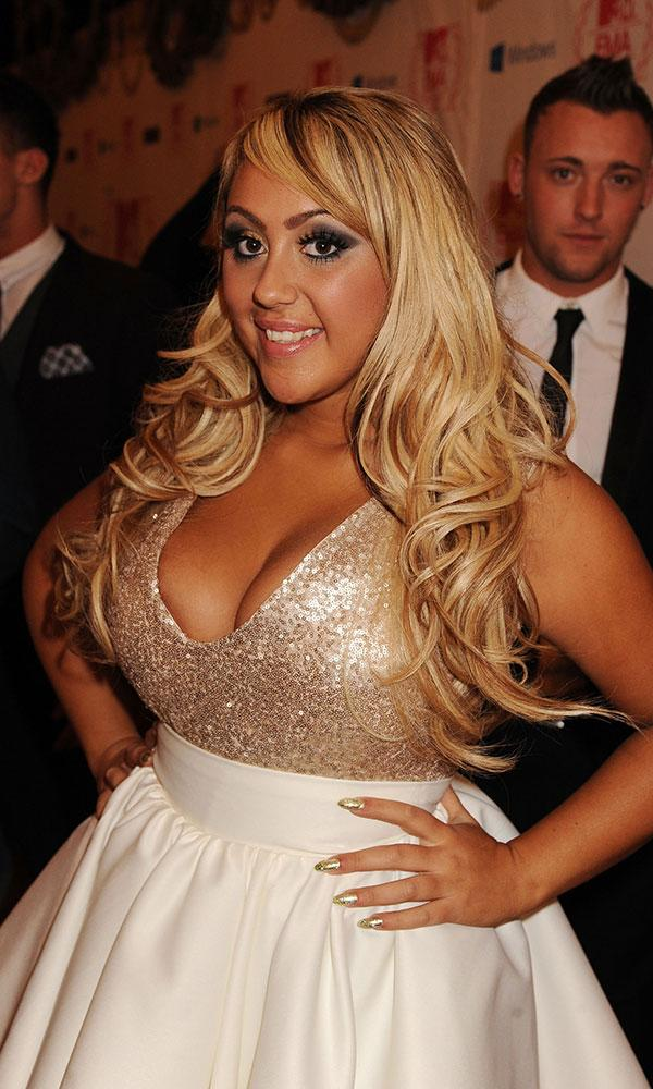 Sophie Kasaei in a gold sparkly dress with blonde hair