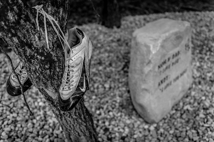 <p>Daniel Weidle's memorial park also honors his cousin, Andy Genslinger — a talented football player whose cleats hang above his memorial rock. (Photograph by Mary F. Calvert for Yahoo News) </p>