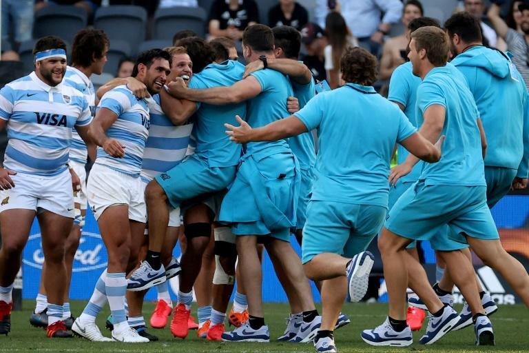 Day to remember: Argentina's players celebrate their victory over the All Blacks